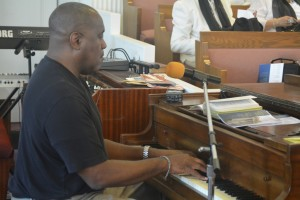 Gary Brooks plays the piano during Sunday service at St John Baptist Church on September 11, 2016. Brooks is very active in the church, holding positions including deacon, musician, and Sunday school teacher.